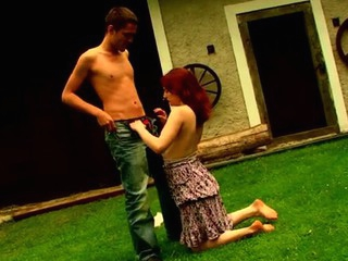 Filthy redhead bitch is fucking with her partner on the grass